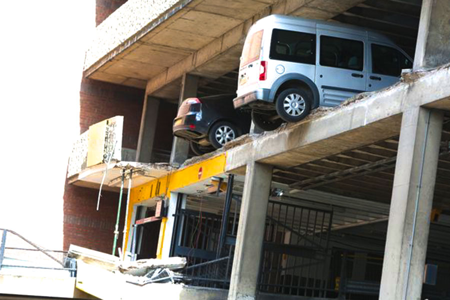 The car park was in a state leaving vehicles hanging after the collapse